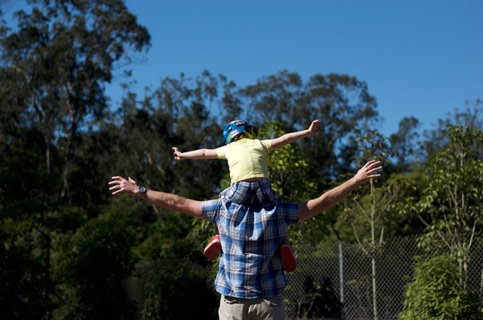 Flying on daddy's shoulders