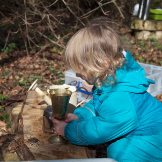 Imaginative play in the mud kitchen.